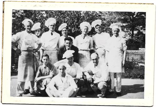 Oude foto van het bakkersteam